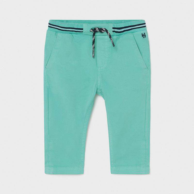 Corte chino en color aqua, cintura goma ancha ajustable, bolsillos en lateral y detrás con botón. Consultanos tenemos distintos colores.