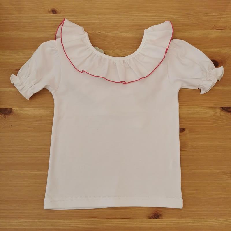 Camiseta Greta ribete fuxia Farfala kids. Manga corta, bonita espalda con lazada en tela, ribeteada por cuello y espalda. Super bonita.