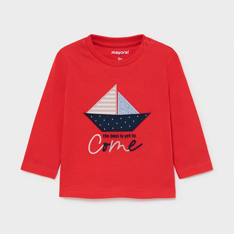 Camiseta manga larga lisa barco bebé niño. Cuello redondo con detalles al tono. Modelo de corte recto. Cierre con botones a presión.