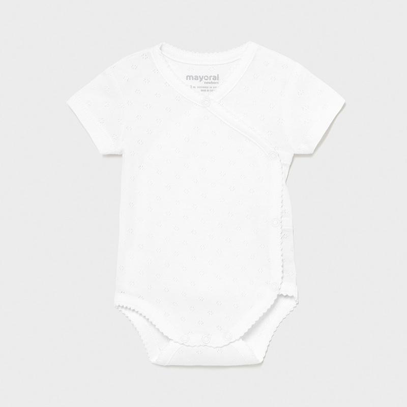 Body manga corta básico bebé recién nacido. Body de manga corta. Cuello redondo. Cierre con botones a presión. Tejido 100% algodón.