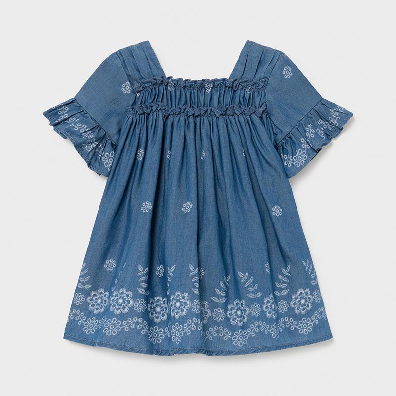 Vestido tejano fluido bebé niña Mayoral. Cuello cuadrado. Suave tejido denim de punto de gran comodidad y elasticidad. Estampado floral.